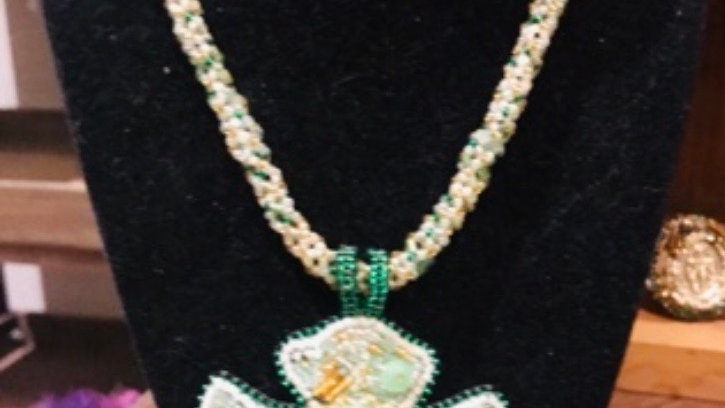 Cross hand beaded necklace in green