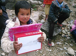 Child receiving Christmas gifts.png
