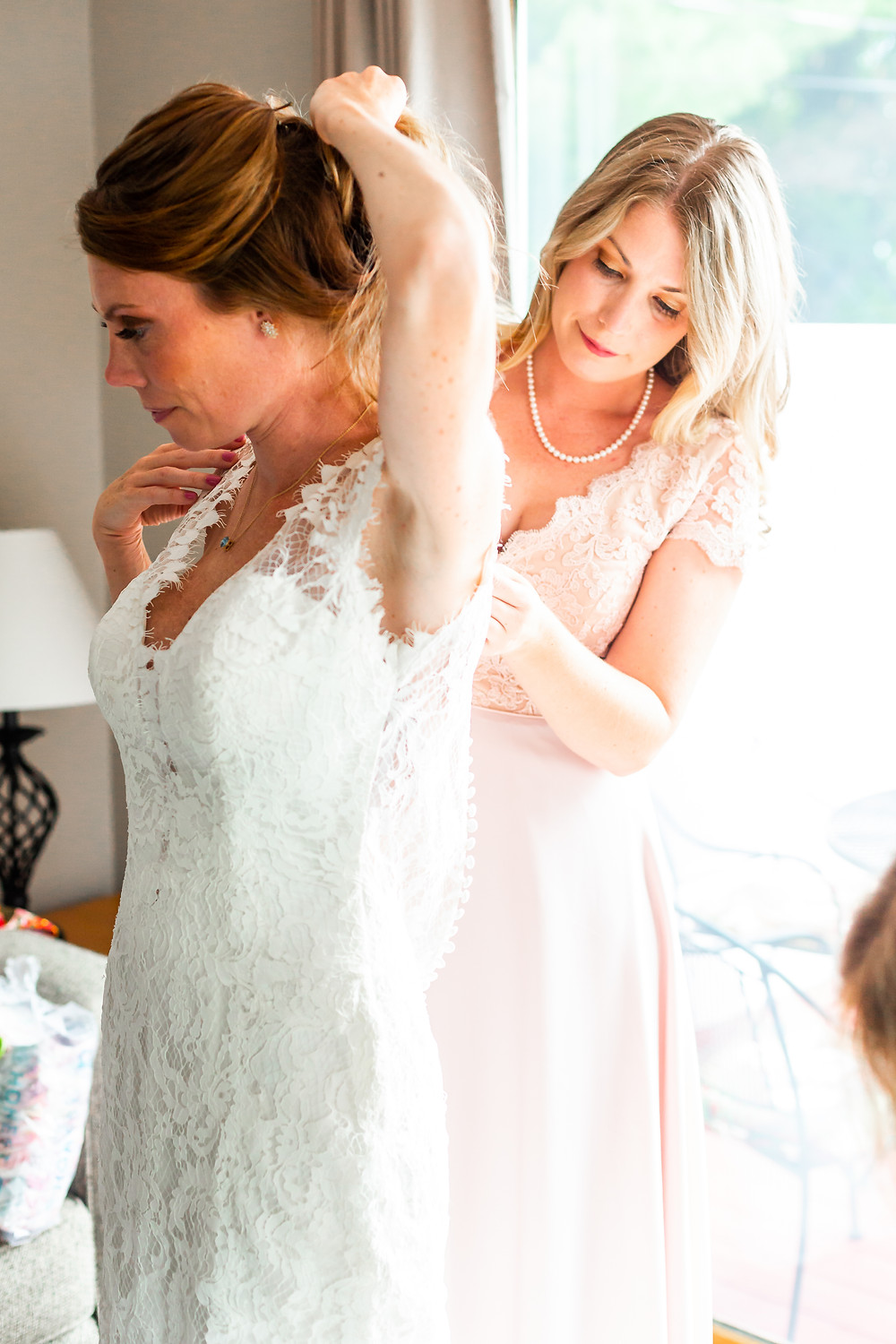 Bride getting ready at her wedding in laconia New Hampshire.