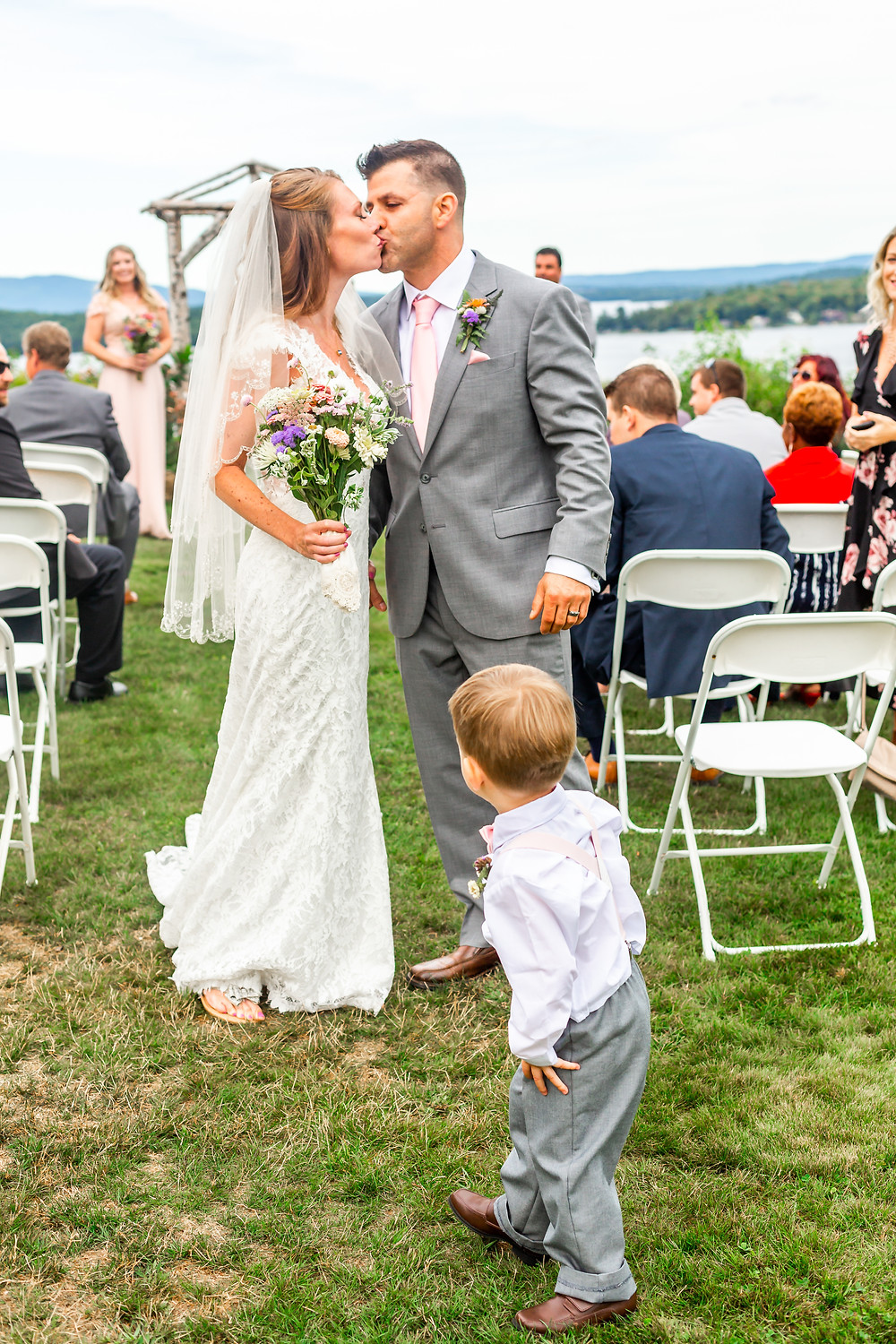 The kiss captures by Elizabeth Ivy Photography, intimate wedding photographer based out of Wells Maine.