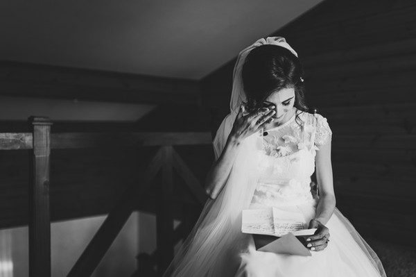 Beautiful bride reading letter from the