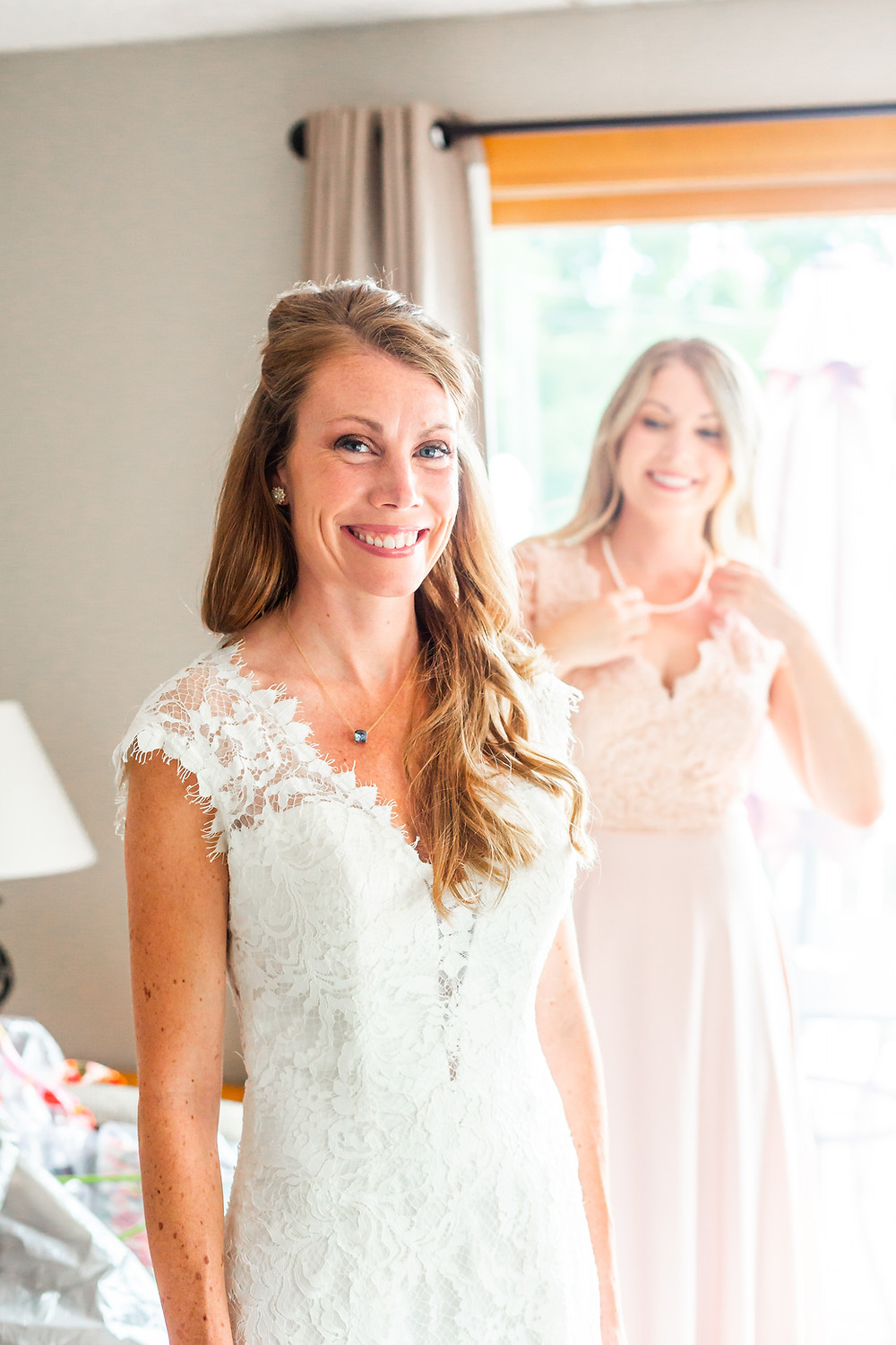 New Hampshire Wedding Photographer captures the bride glowing just before the ceremony at grandview resort.