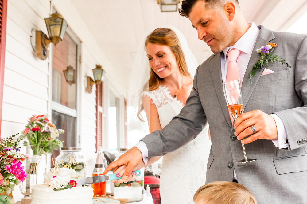 Bride and groom cut the cake on their wedding day at the Grandview Resort in Laconia New Hampshire.