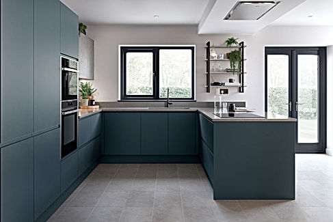A dark blue j handle kitchen design.