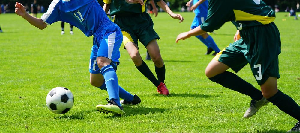 Footballers playing football