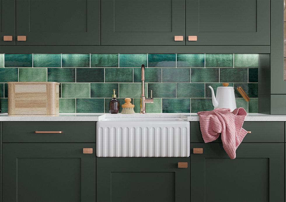 Dark green shaker kitchen with brass handles.