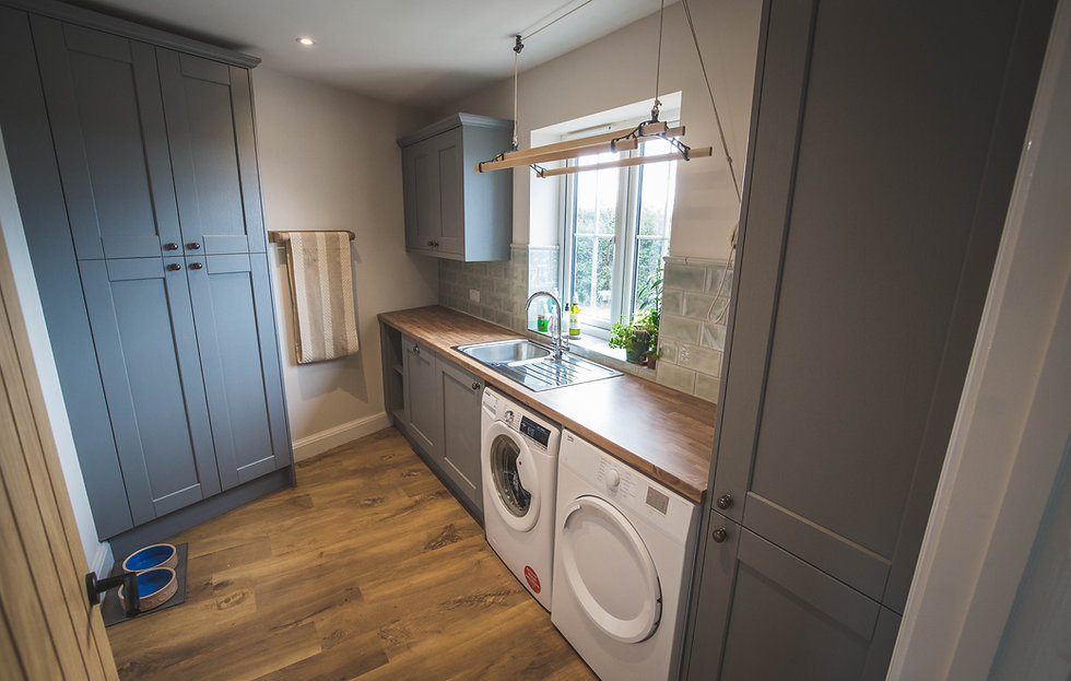 A real customer's utility design with grey shaker doors.