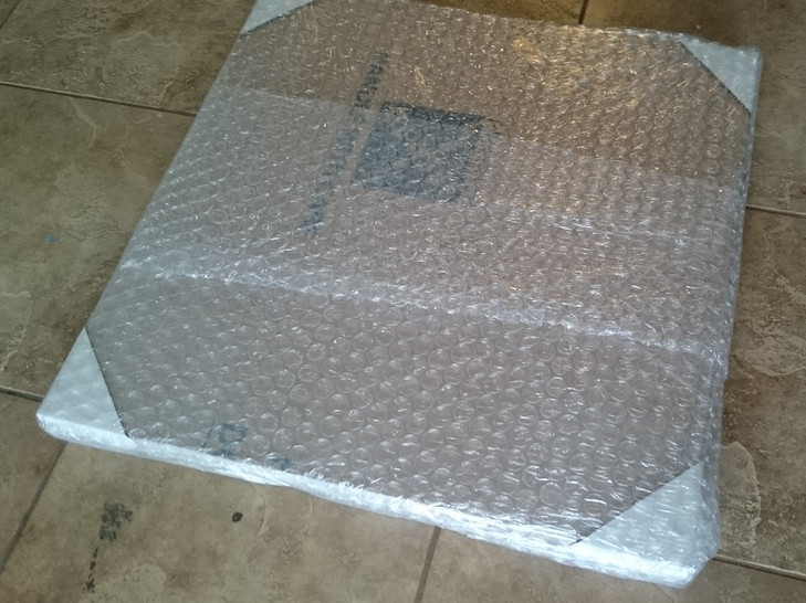 Another layer of protection is added to the corners and then bubble wrapped.