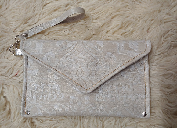 Pressed leather clutch in pearled ivory