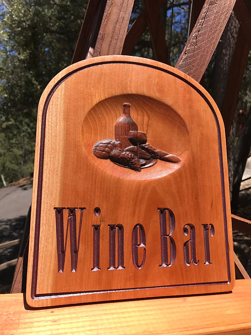 Small carved wooden wine bar sign
