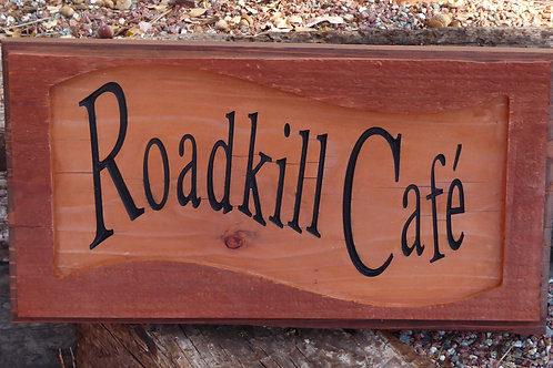 "Carved ""Roadkill Cafe"" sign"