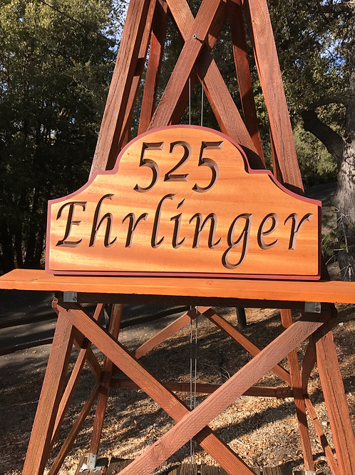 Carved mahogany family name/address number sign.