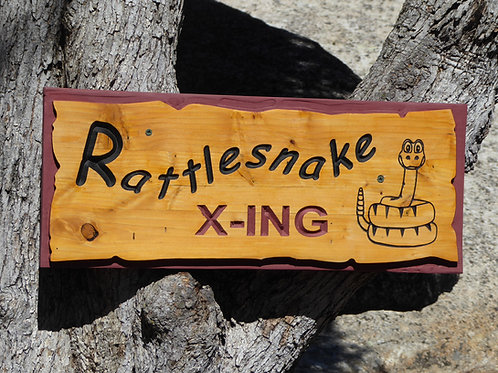 "Rustic carved ""rattlesnake crossing"" sign"