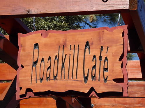 "Rustic wooden carved ""roadkill cafe"" sign"
