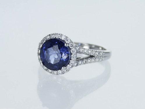 Bague en or 14 karat sertie d'un saphir bleu synthétique et diamants