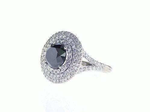 Magnifique bague sertie d'un diamant noir et pavage