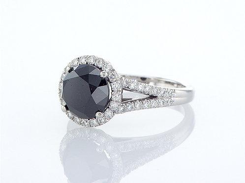 Bague sertie d'un diamant noir et pavage diamants blancs