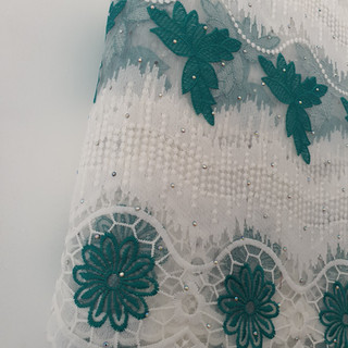 Green & white lace material