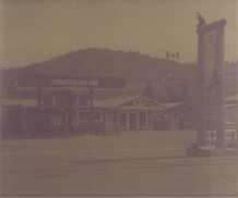 Photo of empty gas station colored brown
