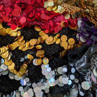 Lenços de quadril com moedas