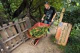V&F volunteer in garden wheelbarrow.jpg