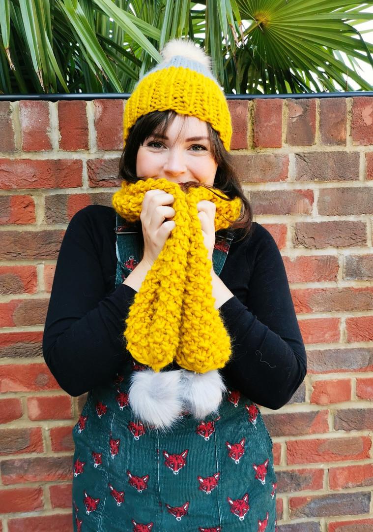 Yellow pompom scarf