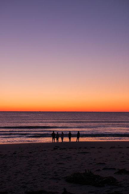 Travellers Admiring an East Coast Sunrise