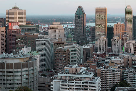 City View Over Montreal. Tall Buildings in Foreground and River and Bridge in Background