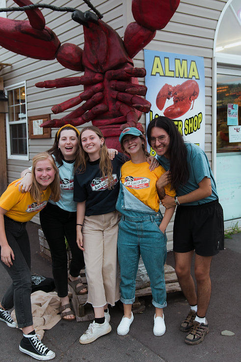 Group of Travellers Smiling Outside an East Coast Lobster Shop