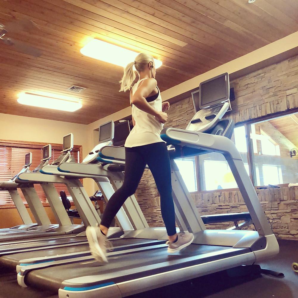 Fitness Trainer on Treadmill