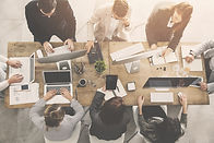 Group of People Collaborating at a Desk