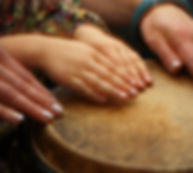 Hands  of teacher and student on drum.jp