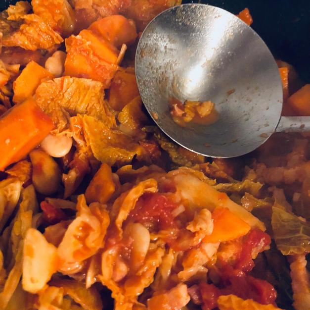Add chicken stock, chorizo....
