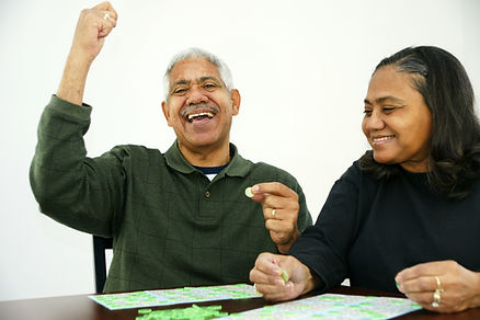 People playing bingo with chips and card