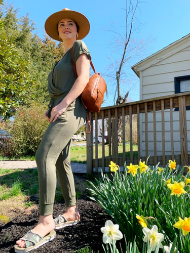 Z SUPPLY Cross Front Jumpsuit in Clover ($84); available in XS, S, M, L, and XL  Hobo Cliff Backpack in Toffee (originally $258, on SALE $180)   Nalho Kamala slides in Camo ($65); available in 7, 8, 9, and 10