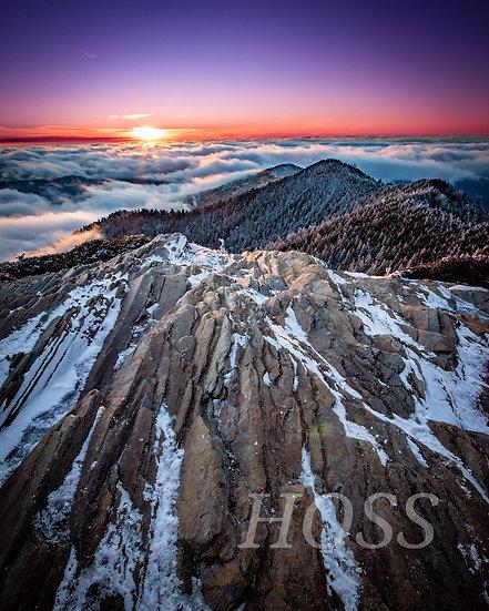 Snowy Sunset on Cliff Tops