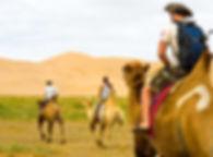 Mongolia-deser-camel-riding-tourist.jpg