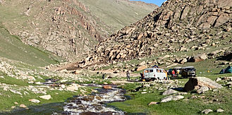 Mongolia-travel-rusian-van-in-the-river-