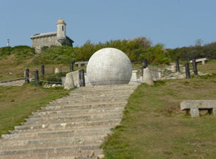 Looking up at the stone Globe at Durlston Castle