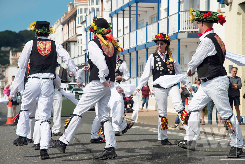 Morris Dancers perform for the crowds during Sidmouth FolkWeek at Sidmouth in Devon.