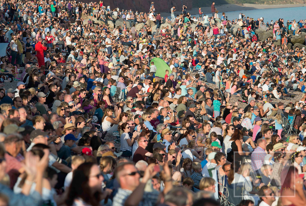 Thousands gather on Sidmouth beach to watch the Red Arrows aerobatic display team perform their amazing death-stunts.