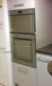 Encastrement d'appareils ménagers (fours) réalisé par Régis Planes, artisan menuisier agenceur de Bordeaux, Gironde - 33610 Cestas.