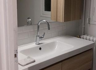 Meuble de salle de bain, installation de Régis Planes Agencement.