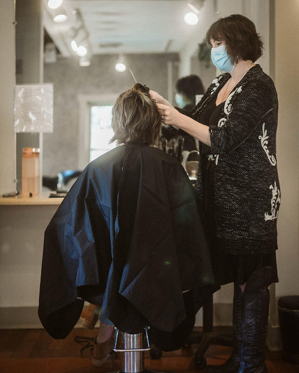 Salon manager Amanda Flick at her station with a guest. Photo by Kairos Creative Co./Sam Lucas