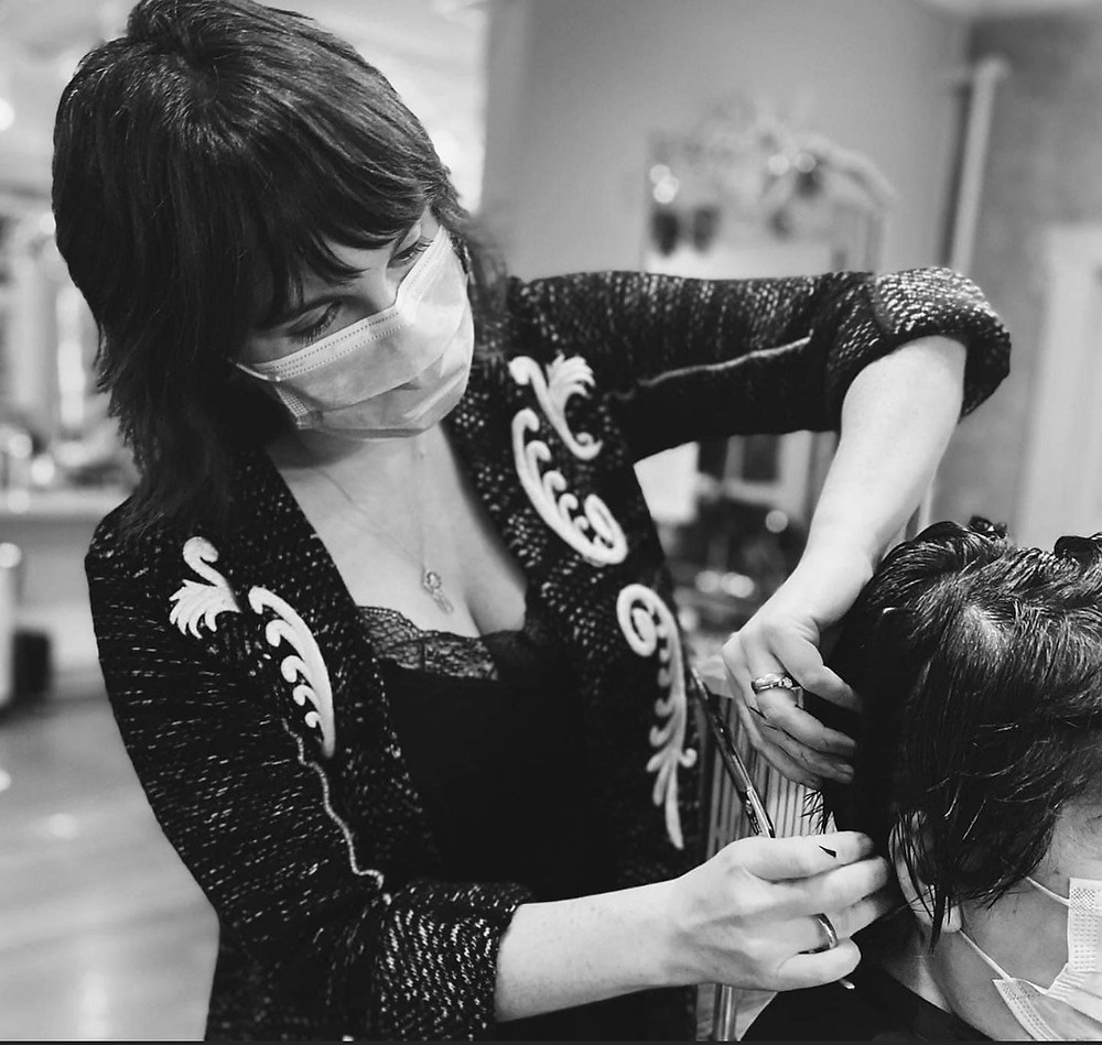 Master Stylist and Owner Amanda Flick cutting hair