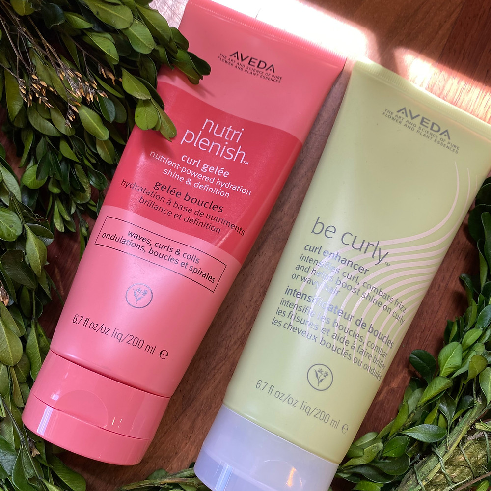 Nutriplenish Curl Gelee and Be Curly Curl Enhancer products with green boxwood garland