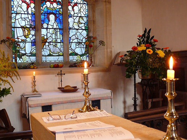 Church chancel with stained glass window