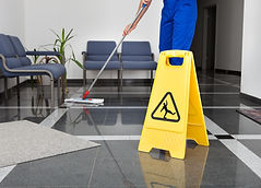 Close-up Of Man Cleaning The Floor With