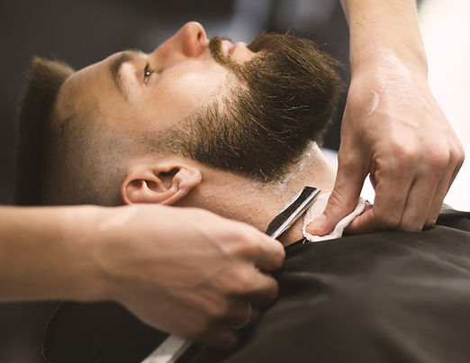 Professional barber doing a haircut