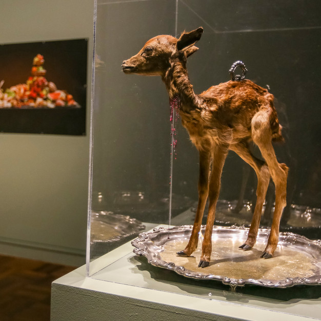 Julia deVille Sentience, 2012 stillborn deer, glass, rubies 18.45ct, pear cut garnet 0.76ct, 18ct white gold chain and wire, sterling silver, bronze, black rhodium,on antique Wallace platter, 49 x 49 x 51cm Collection Bendigo Art Gallery The Gift of Grace and Alice Craig, Bendigo Victoria, 2014. courtesy the artist and Sophie Gannon Gallery. © the artist